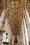 Slender columns and aisle of a large church in the town of Dinkelbur in Germany Royalty Free Stock Photo