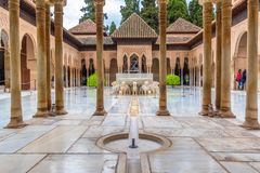 The most beautiful place in the Nasrid Palace is the Lion Patio Patio de l in rainy weather. Alhambra, Granada, Andalusia, Spain. stock images