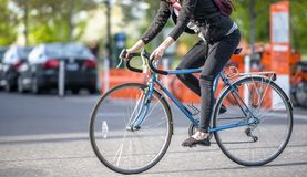 Slender female cyclist is in great shape because she rides bike