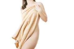 Slender female figure in a towel Royalty Free Stock Photos