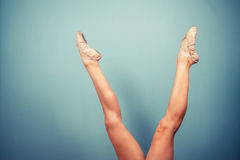 Slender female legs in ballet slippers Stock Image