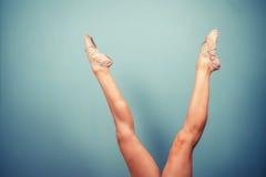 Slender female legs in ballet slippers Stock Image