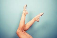 Slender female legs in ballet slippers Stock Photos