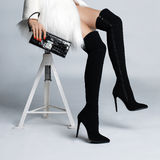 Slender female legs in boots stockings Royalty Free Stock Photography