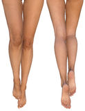 Slender female legs with stretched out feet - front and rear views. A CG illustration of Caucasian female legs from thighs to feet - front and rear side views Stock Photos