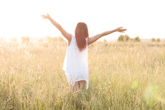 The slender figure  girl running hot summer afternoon, in a dress, concept  happiness, pleasure, sunrise and sunset, one. The slender figure of the girl running Stock Photos