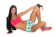Slender fitness reclining girl posing Royalty Free Stock Image