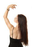 Slender girl from a back looks at a bracelet Stock Images