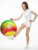 Slender girl with a big ball Stock Images