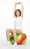 Slender girl with a big ball Stock Photo