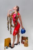 Slender girl with gifts Stock Photos