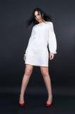 Slender girl in mini dress Royalty Free Stock Photo