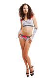 Slender girl in polka dot erotic clothes with bows Stock Photography