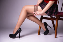 Slender girl putting on stockings Stock Image