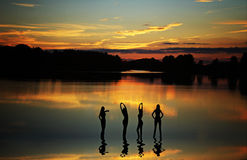 Slender girl shadows at sunset Royalty Free Stock Photography