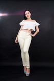 Slender girl in trousers Royalty Free Stock Images