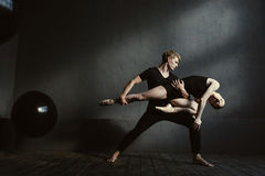 Slender gymnasts dancing in interaction with each other Stock Image