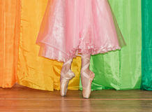 Slender legs of a ballerina clad in Pointe shoes, standing on to stock image