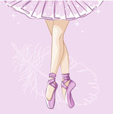 Slender legs in ballet slippers. Stock Image