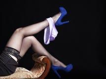 Slender legs lying girl in black stockings with panties Royalty Free Stock Photo