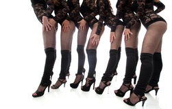 Slender legs of young dancers, close-up Royalty Free Stock Images