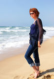 Slender middle-aged woman at the sea Royalty Free Stock Images
