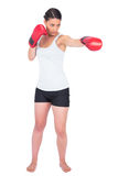 Slender model with boxing gloves punching Royalty Free Stock Photos