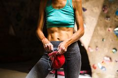 Free Slender Rock Climber Holds A Chalk Bag Royalty Free Stock Image - 151813816