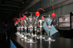 Slender rows of empty cocktail glasses on the bar. Decorated with icing. Stock Photography