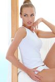 Slender seductive blond relaxing in her underwear Royalty Free Stock Photos
