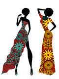 Slender stylish women in ornate ethnic long dresses. Slender stylized young models in ornate colourful motley ethnic long dresses, vector stencils isolated on Stock Photo