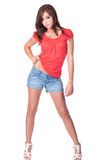 Slender teen girl in red and blue Royalty Free Stock Images