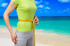 Slender woman on the beach Stock Images