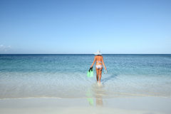 Slender woman in a bikini goes to swim Stock Images