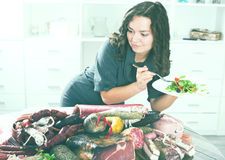 Slender woman chooses healthy food Stock Images