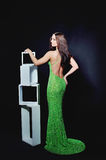 Slender woman in a cocktail dress green Stock Photography