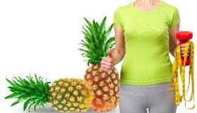 Slender woman, fruits and vegetables. Diet and health Royalty Free Stock Image