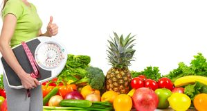 Slender woman, fruits and vegetables. Diet and health Stock Photos