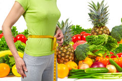 Slender woman, fruits and vegetables Royalty Free Stock Photo