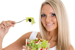 Slender woman holds a bowl of salad. Royalty Free Stock Photo