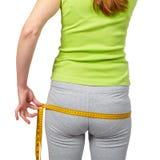 Slender woman measuring her waist Stock Image