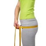 Slender woman measuring her waist Royalty Free Stock Photo