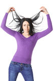 Slender woman raises hair hands isolation Royalty Free Stock Photography