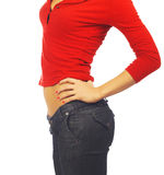 Slender woman in red shirt and jeans Stock Photo
