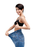 Slender woman wearing enormous jeans Stock Photo