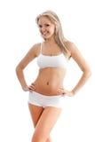 Slender woman wearing white underwear Royalty Free Stock Photography