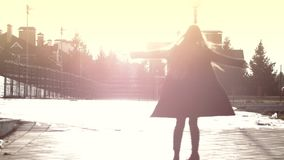 Slender woman whirling against vivid sunny sky and long hair fly around. Emotional stock footage