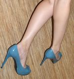 Slender women`s legs without tights, high-heeled shoes. stock photography