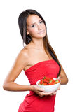 Slender young brunette holdng strawberries. Royalty Free Stock Images