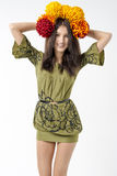 Slender young brunette woman in a dress with a bouquet of autumn flowers on her head Stock Photos